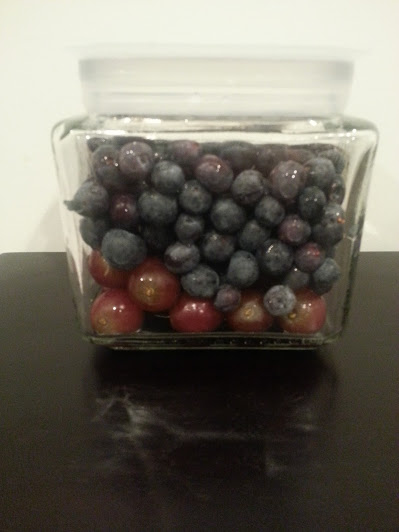 berries filling jar