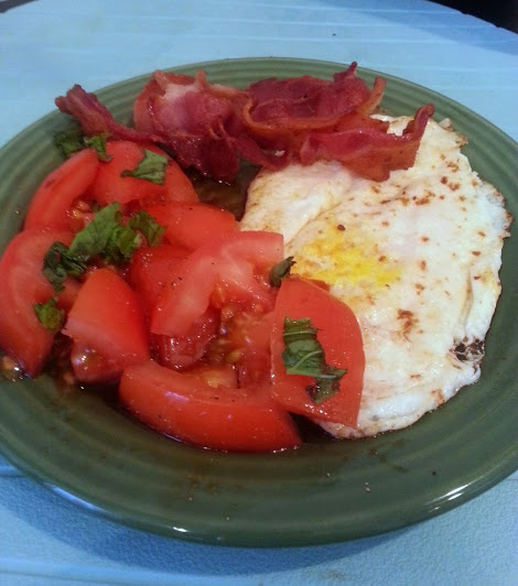 egg, tomato basil salad, and bacon